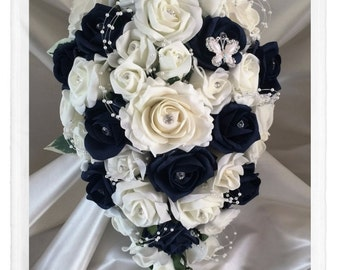 Wedding Flowers Navy Blue & Ivory wedding bouquets with butterflies, Brides, Bridesmaids, Flowergirls etc