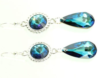 The earrings are made with Swarovski crystal and the color is Bermuda blue. They are teardrop earrings with sterling silver ear-wires.