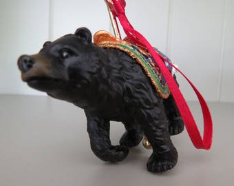A very unusual vintage hanging carousel ride featuring a black bear.