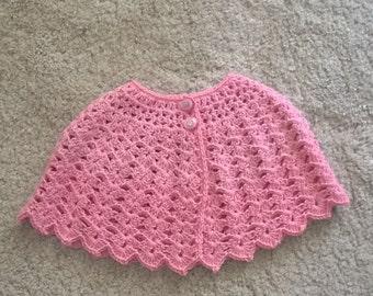 Pink crochet poncho