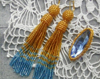 Earrings-hand and bead brooch