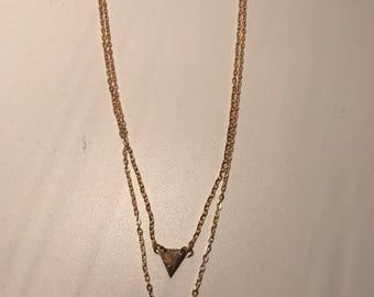 Gold toned double triangle necklace
