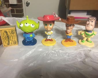4 cereal toys by Kellogs Toy Story bobble heads from the 1990's Alien, Buzz, Jessie, Woody