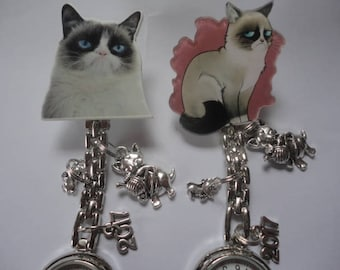 Sour Puss Nurse Watch Clip On Backing with Tibetan Silver Charms plus Spare Battery UK Buyers Only