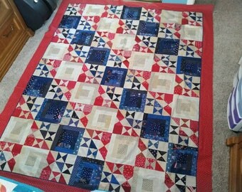 Scrappy red white and tan quilt top