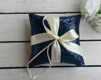 Navy sequin ring pillow