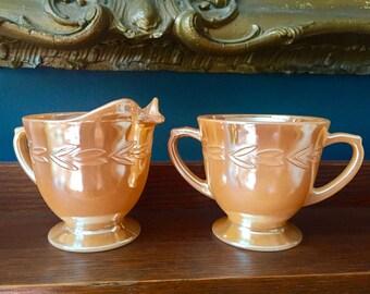 Fire King peach lusterware creamer and sugar bowl