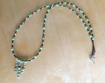 Dainty earth green gemstone necklace .