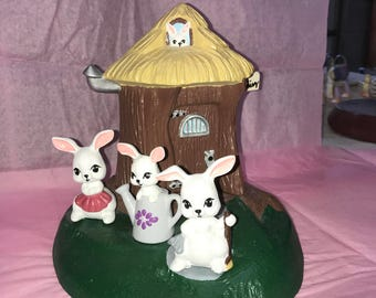 Tree stump house with bunnies