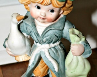 Ceramic Boy with Goose and Bag