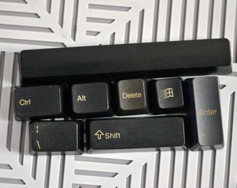 Magnets in decorative fridge made from computer keyboard keys