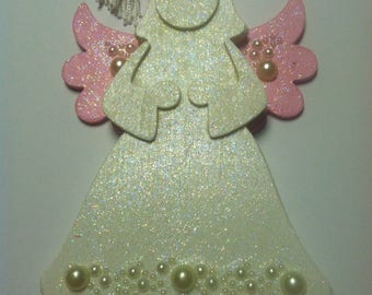 Wooden Angel air freshner/ornament. Has a tassel that fragrance may be added to freshen up a room or car
