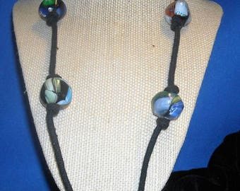 Rustic trade beads on leather