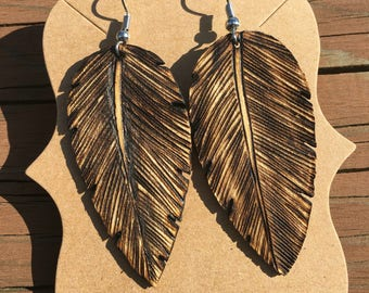 Hand carved wooden feather earrings