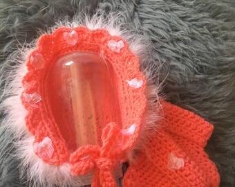 Pink crochet baby bonnet and booties