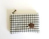 mini zipper pouch  - navy plaid with a hedgehog applique