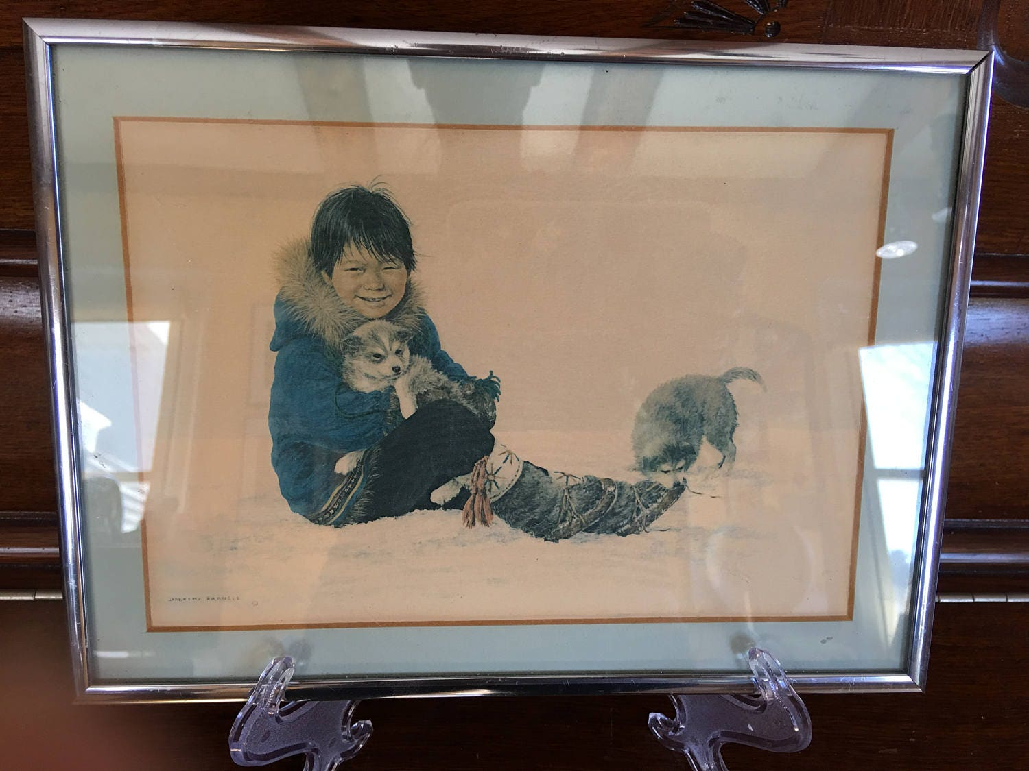 dorothy francis lithograph inuit child holding a puppy framed