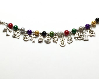 The 12 days of Christmas charm bracelet.  Bright Colored faux glass pearls and Silvertone charms. Stocking stuffer, gift for her