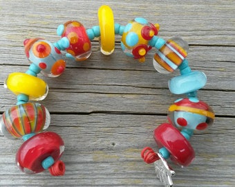 Handmade Lampwork Bead set by JudyDalyReganti-Circus Light Turquoise Red and Golden Yellow Bead Set