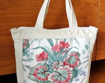 Unique one-of-a-kind new/unused tote handbag of multicolor printed linen flower/ leafe motive and creame white skin/leather