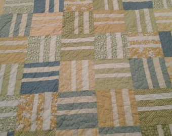 King size turquoise,  blue, yellow and cream quilt