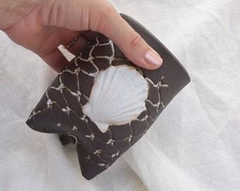 Seashell cup, toothbrush holder, Fishnet and shell tumbler. Black and white ocean inspired handmade pottery, wedding gift