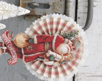 Vintage Inspired CHRISTMAS Victorian SANTA Holding a Bag of Toys Standing on Spool Rosette Winter Red White