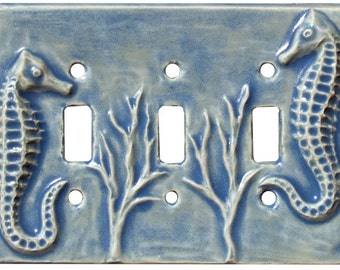 """Seahorses Ceramic Triple Toggle Switch Plate in Light Blue Glaze (7 1/4"""" wide x 5 1/8"""" tall)"""
