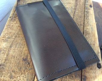 Sleek brown Leather passport cover with pocket for cash and cards