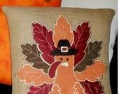 Turkey swead applique on burlap, lined, 18x18.