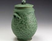 Carved Oak Leaf Green Jar With Acorn Knobs
