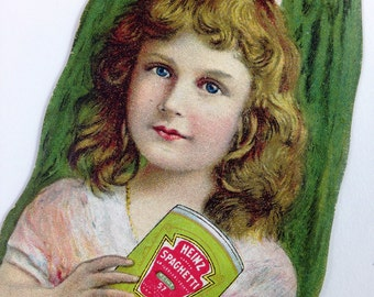 Vintage Heinz Trading Card Shaped Like a Pickle with Girl Holding a Can of Heinz Spaghetti