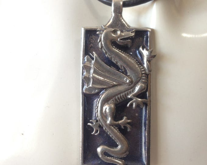 Dragon with blue backround on leather necklace. Handmade in Australia. Pewter and Resin