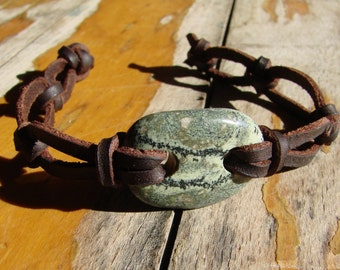Celtic knotted wristband with Serpentine stone
