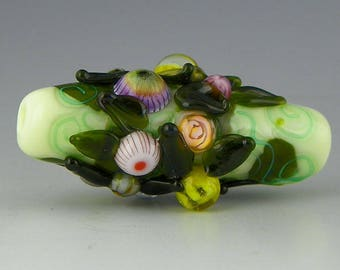 a tube focal in pale green with raised murrini buds and dark leaves handmade lampwork glass bead - Wildflower Bouquet
