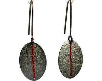 Oxidised Silver oval disc earrings stitched with a deep coral thread