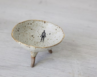 Hand built  White Speckled  shallow Bowl with cute tripod feet, Gold Trim, and Tiny Human
