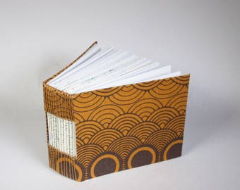 Bitty Mini Blank Book with a Page for Every Day of the Year with a Rigid Brown Fabric Cover and Recycled Story Book Paper