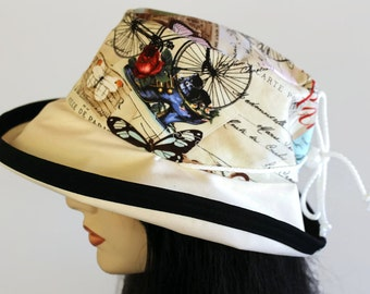 Sunblocker UV summer hat sun hat with wide brim featuring colourful Paris print and adjustable fit