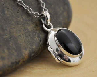 oval black onyx stone sterling silver locket necklace. simple everyday wear. photo locket.