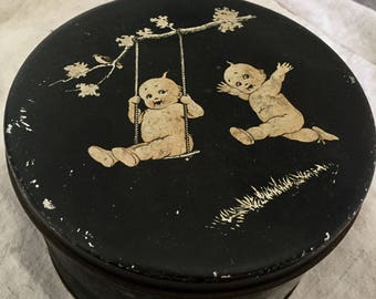 Antique Kewpie cookie tin, hand painted 1910.