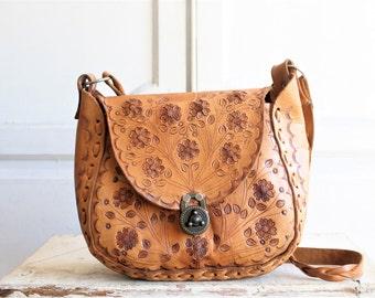 vintage tooled leather saddle bag   woven leather bag