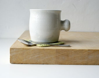 Two tulip shaped mugs - hand thrown stoneware glazed in brilliant white