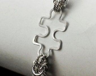 Puzzle Piece Twisted Elegance Bangle Bracelet