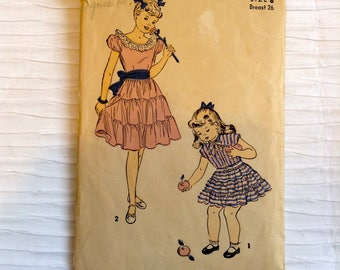 Vintage 1940's Girl's Day or Party Dress sewing pattern.   Advance. Girl's Size 8.   No. 4854.