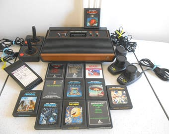 Atari CX-2600A 4 Switch Woody with Cords, Controllers, a Star Raiders Video Touch Pad and 12 Games Tested and Works