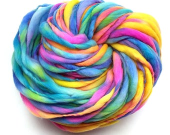 Super bulky handspun rainbow yarn, 65 yards and 3.25 ounces/ 92 grams, spun thick and thin in merino wool