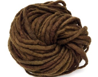 Hand spun felted yarn, spun thick and thin in merino wool - 18 yards and 1.4 ounces/ 40 grams