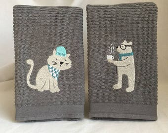 Set of embroidered hipsters on grey horizontal bar towels