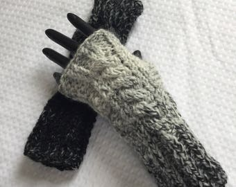 Hand knit black and white contrast cabled ribbed wool fingerless gloves